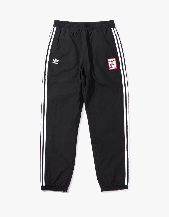 have a good time HAGT X ADIDAS Reversible Track Pants - Black | HEIGHTS. | International Store